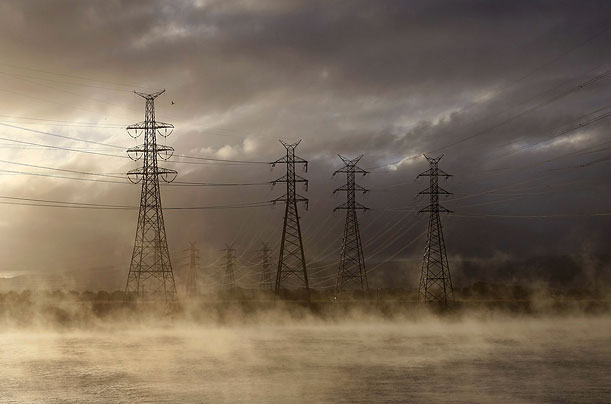 Mist is seen coming from the cooling pond at the brown coal Hazelwood Power Station in Latrobe Valley near Melbourne December 15, 2008.