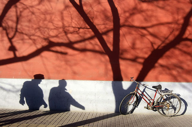 Shadows are seen on a wall near the Zhongnanhai compound in Beijing.