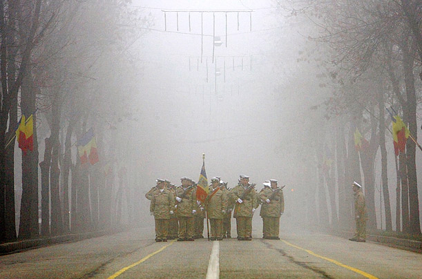 Romanian Marines prepare to take part in a National Day mililtary parade in Bucharest, Romania.