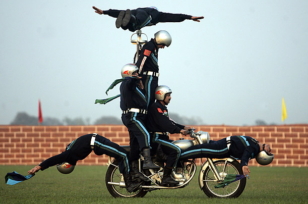 Indian army soldiers perform a stunt during the pre-celebrations of Vijay Diwas, a ceremony to celebrate the liberation of Bangladesh by the Indian Armed forces,in Kolkata, India.