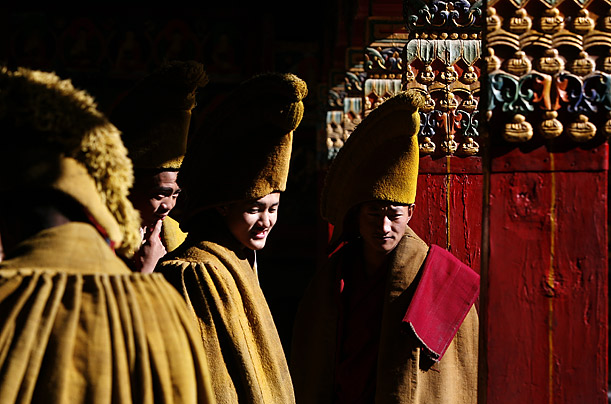 Lamas prepare for an afternoon prayer session at a monastery in Tibet.