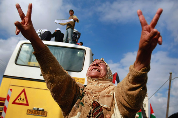 A woman celebrates the release of 227 Palestinian prisoners by Israel in the West Bank city of Ramallah.
