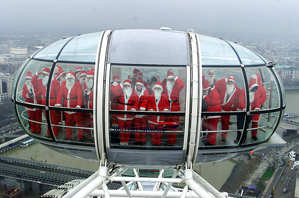 Santas from the Metropolitan Police and London Fire Brigade take a trip on the London Eye as part of an event to support of the Linda McCartney Cancer Centre.