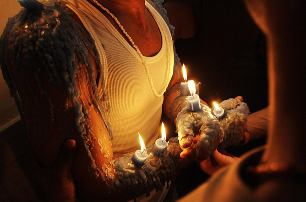 At the Rincon church in Havana, Cuba, Juan Carlos Calvealt Villazana carries