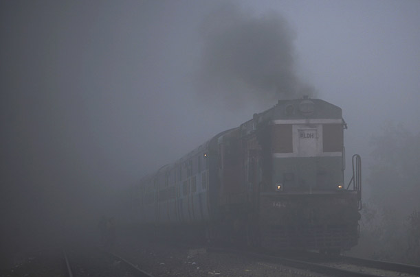 A train moves through heavy fog in Jammu, Kashmir.