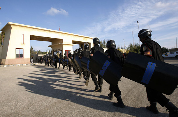 Egyptian riot police prepare to stand guard at the Rafah border crossing as wounded Palestinians trickle in from Gaza into Egypt.  