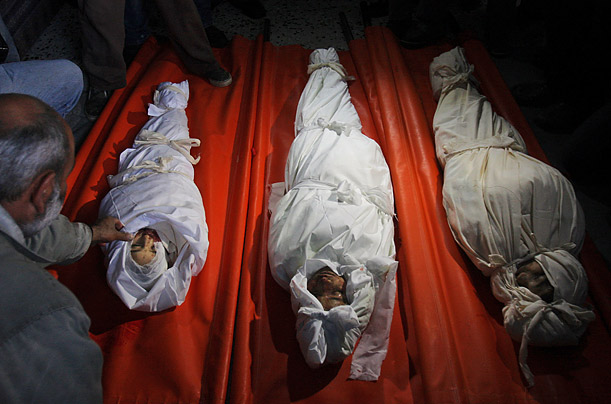 Three Palestinian brothers who were killed in an Israeli missile strike are prepared for burial in the Rafah refugee camp.