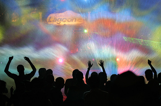 Revelers dance in front of a laser water show during a New Year's celebration in Malaysia.