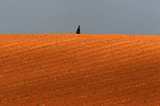 An Israeli soldier crosses into Israel from the northern Gaza Strip.
