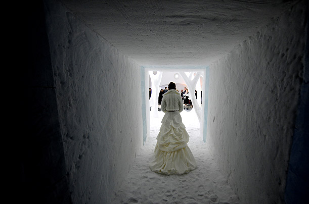 A bride enters the chapel of the ICEHOTEL in Jukkasjaervi, Sweden, for her wedding. Around 150 couples tie the knot at the chapel each winter; in the spring, the hotel melts away.