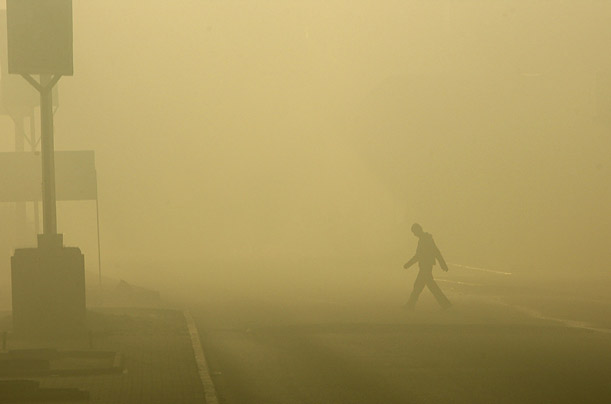 A Palestinian walks through smoke during Israel's offensive in northern Gaza Strip.