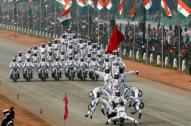 Daredevil motorcycle riders perform during a full dress rehearsal for the Republic Day parade in New Delhi, India.