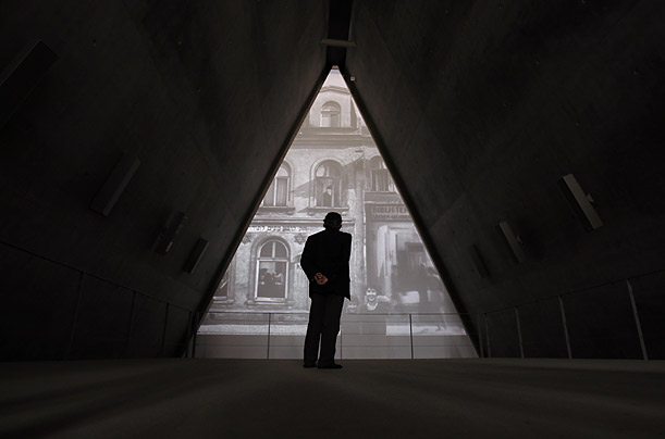 A visitor watches a video installation at the Yad Vashem Holocaust History Museum in Jerusalem.  Tuesday marks the International Day of Commemoration to honour the victims of the Holocaust.