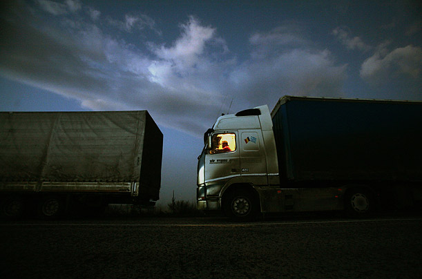 A truck waits in line to pass the border between Greece and Bulgaria. Greek farmers protesting against low prices set by the European Union for their goods have caused backups at the border crossing by blocking the road with their tractors.