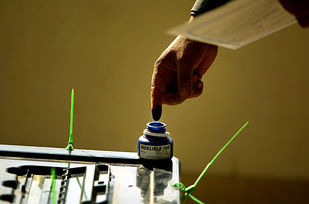 A man dips his finger in ink after voting in the country provincial elections in Baghdad.