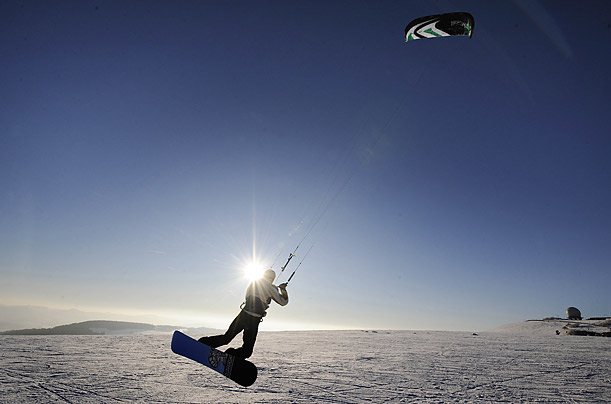 A snow kiter slides down the Wasserkuppe peak in western Germany.