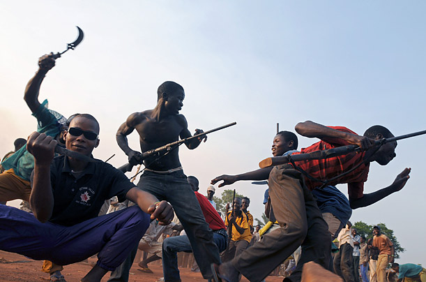 Fighters of a local self-defense force go through practice exercises in Bangadi, northeastern Congo. Villages from attack by Ugandan rebels of the Lord's Resistance Army.