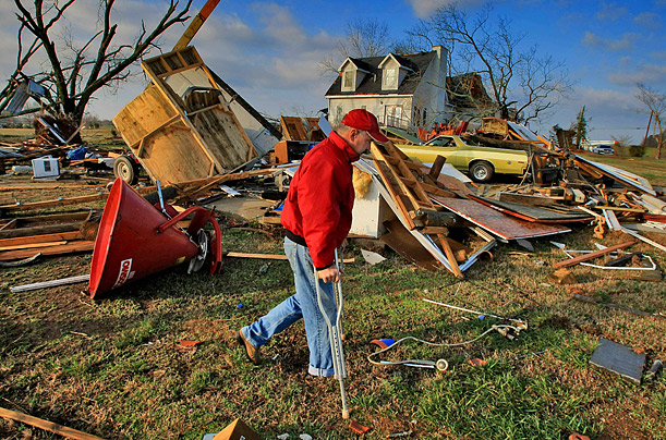 Robert Skinner surveys his destroyed home in Moreland, Georgia after losing six cars, a tractor and his shop to severe storms that swept through the area southwest of Atlanta.