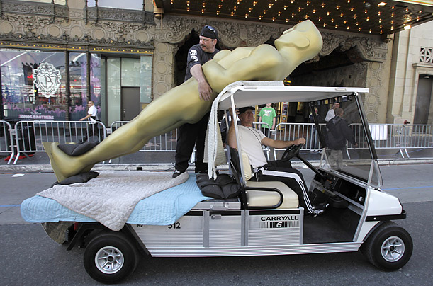 Workers make preparations for the upcoming Academy Awards in Los Angeles, California.