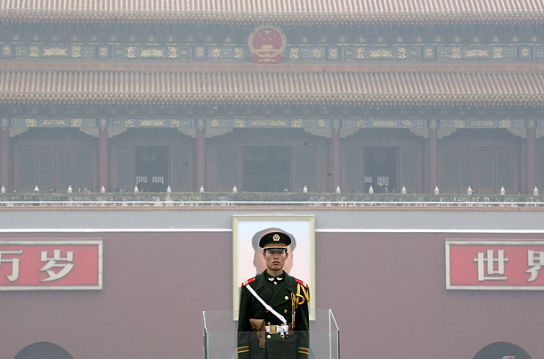 A paramilitary policeman stands guard at Beijing's Tiananmen Square, China.