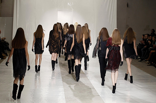 Models models leave the runway after a Paris fasion week show by Irish designer Sharon Wauchob.