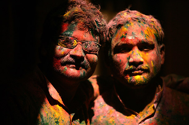 In the northern city of Mathura, Hindu devotees celebrate the festival of Holi by throwing colored powder on each other.