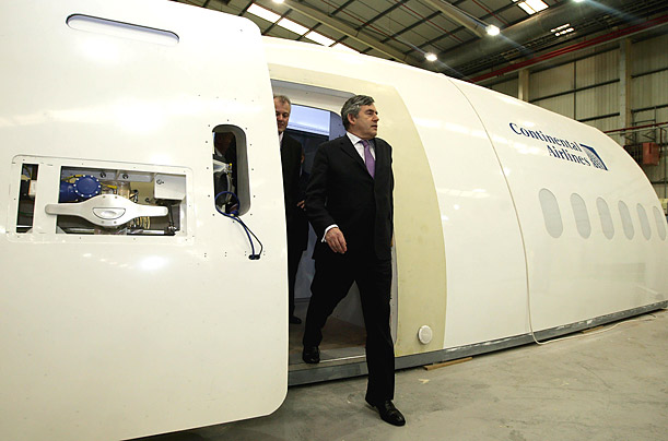 Prime Minister Gordon Brown exits a cabin crew training simulator in
