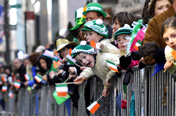 People cheer New York's annual St. Patrick's Day Parade as it makes its way up Fifth Avenue.