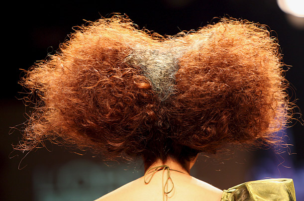 A model displays a hair creation by L'Oreal Professional during the Bangkok International Fashion Week 2009.
