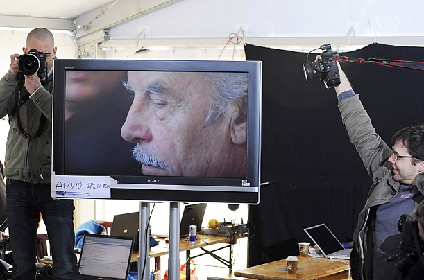 Photographers take pictures next to a television screen, showing defendant Josef Fritzl, in a media tent near the country court in St. Poelten, Austria.  Fritzl was sentenced to
