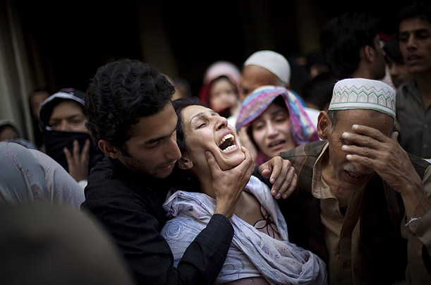 Relatives mourn Raheel Fayz, one of the policemen killed during Monday's attack on a police academy in Lahore, Pakistan, during his funeral.