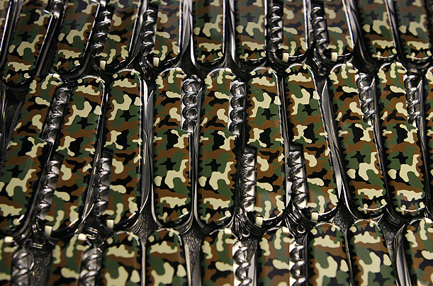 Camouflage pocket knives lie in a box at a Victorinox knife manufacturer facility in Switzerland. The legendary knifemaker is celebrating its 125th year.