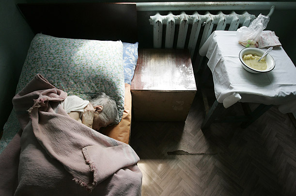 A man sleeps in a senior citizens' home in the southern Russian town of Svetlograd.