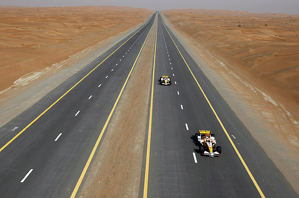 Romain Grosjean and Adam Khan test Renault F1 cars in the desert of Dubai as part of the 
