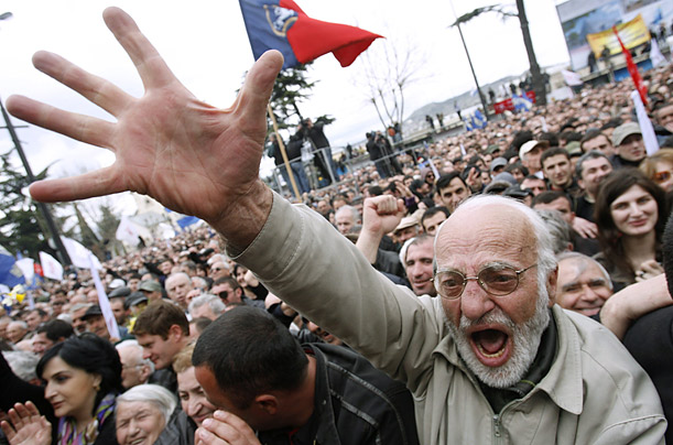 A demonstrator shouts slogans during a protest rally in Tbilisi to try to force President Mikheil Saakashvili to resign.
