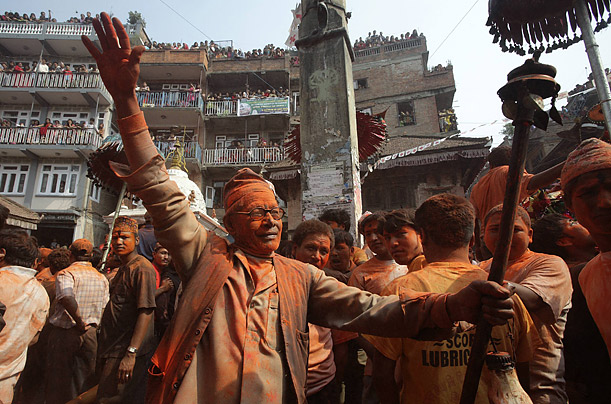 People sing and dance during the second day of Navavarsha, the Nepalese New Year, in Kathmandu.