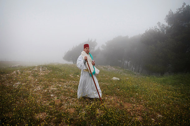 A member of the ancient Samaritan community walks to morning prayers to mark the end of the Passover holiday on Mount Gerizim, near the West Bank town of Nablus.
