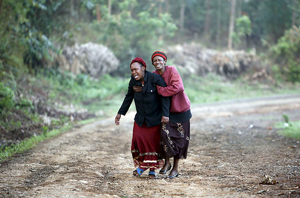 Two residents of Gathaithi Village mourn the killing of their relatives in Nyeri, Kenya. Police sources say 27 villagers were hacked to death in the night raid by the banned sect known as Mungiki.