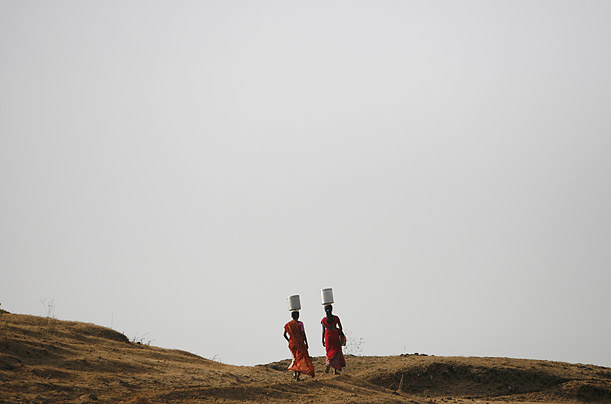 A pair of Indian women head home to their village of Karjat.