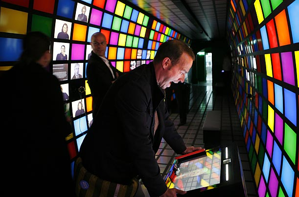 Three men look at the exhibits aboard the science information train 'Expedition Future' in Berlin. The train will visit 62 German cities before November.