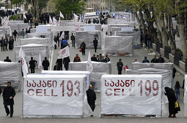 Cages are erected on a street during a rally by Georgian opposition supporters in Tbilisi.