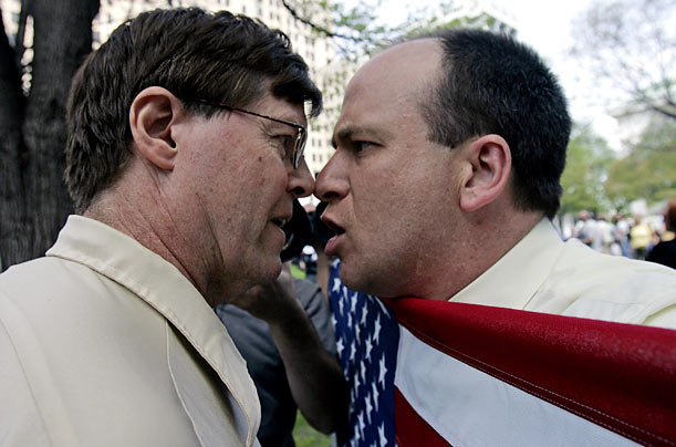 Gay rights advocate Matthew Arnold-Lloyd of Albany, N.Y., right, meets nose to nose with an unidentified man opposed to gay marriage during a rally outside the Capitol in Albany.