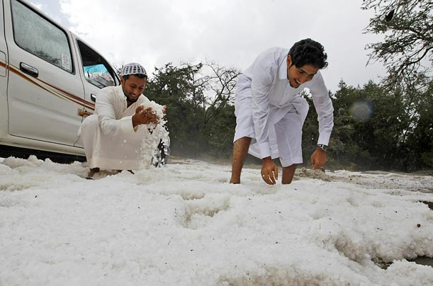 Saudis enjoy a rare snowfall in Al Baha, a city south-west of Riyadh.
