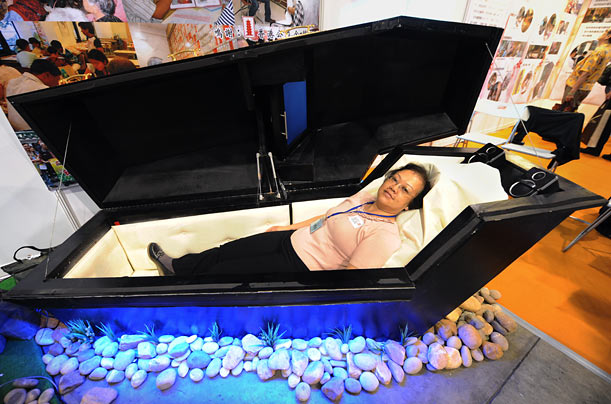 Despite the tumbling economy, the funeral business remains relatively brisk, as evidenced by this multimedia demonstration at the Asian Funeral Expo in Hong Kong.