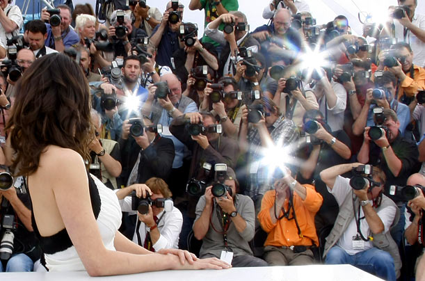 A wall of photographers shoot pictures of Cannes Film Festival jury member and actress Asia Argento.