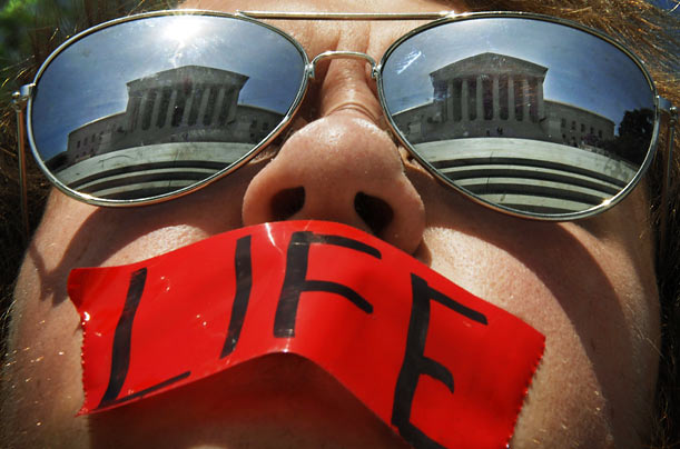 Anti-abortion activist Craig Kuhns protests in front of the U.S. Supreme Court building in Washington, DC.