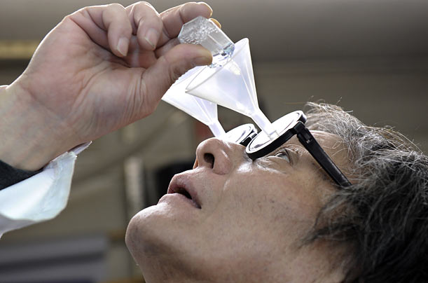 Inventor Kenji Kawakami demonstrates his funnel glasses designed to guide eyedrops so that they never miss their mark.