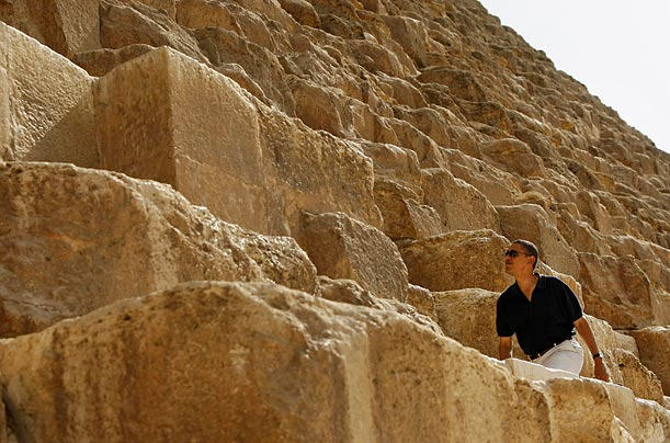 The President climbs a pyramid during a tour in Cairo.