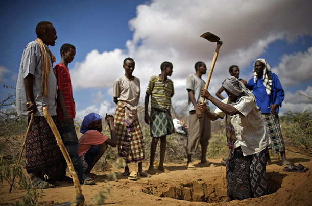 Somali men dig a grave for 20-month-old Anfac Anwar Mohammed after she died from starvation at a refugee camp in Kenya.