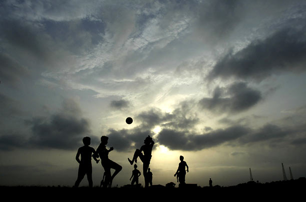 Children play soccer in Bhubaneswar, India.